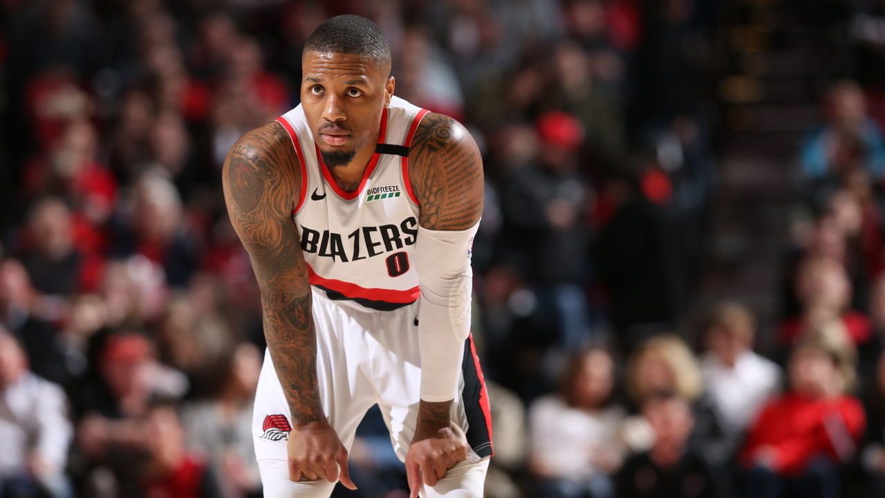 PORTLAND, OR - MARCH 7: Damian Lillard #0 of the Portland Trail Blazers looks on during the game against the Sacramento Kings on March 7, 2020 at the Moda Center Arena in Portland, Oregon. Mandatory Copyright Notice: Copyright 2020 NBAE