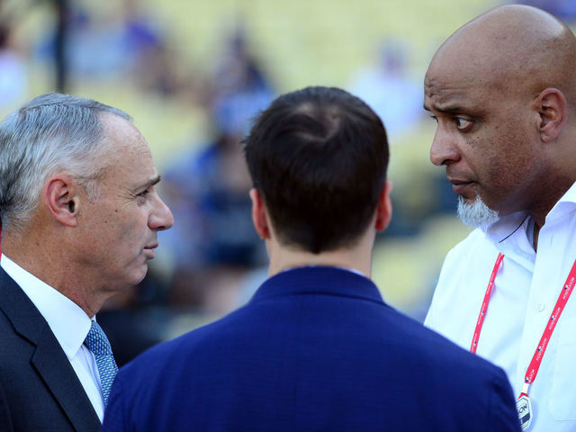 LOS ANGELES CA - OCTOBER 25 Major League Baseball Commissioner Robert D Manfred Jr talks with Executive Director of the Major League Baseball Players Association Tony Clark during batting practice prior to Game 2 of the 2017 World Series between the Houston Astros and the Los Angeles Dodgers at Dodger Stadium on Wednesday October 25 2017 in Los Angeles California