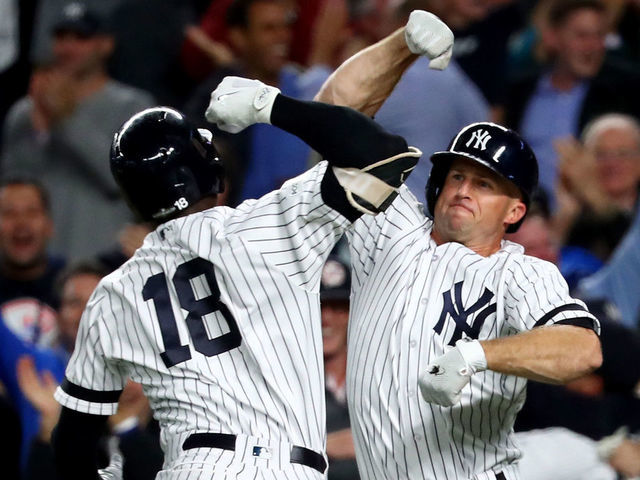 NEW YORK NY - OCTOBER 03 Didi Gregorius 18 of the New York Yankees celebrates with Brett Gardner 11 after hitting a three run home run against Ervin Santana 54 of the Minnesota Twins during the first inning in the American League Wild Card Game at Yankee Stadium on October 3 2017 in the Bronx borough of New York City