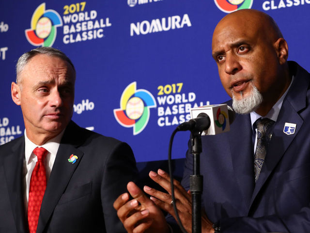 LOS ANGELES CA - MARCH 22 Major League Baseball Commissioner Robert D Manfred Jr and Major League Baseball Players Association Executive Director Tony Clark speak during a press conference before Game 3 of the Championship Round of the 2017 World Baseball Classic between Team USA and Team Puerto Rico on Wednesday March 22 2017 at Dodger Stadium in Los Angeles California