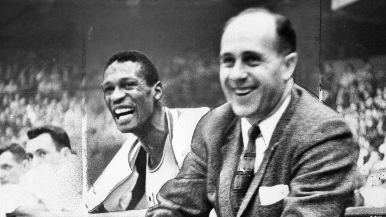 BOSTON - DECEMBER 26: Boston Celtics player Bill Russell and coach Red Auerbach during a game against the Philadelphia Warriors at Boston Garden on Dec. 26, 1956.
