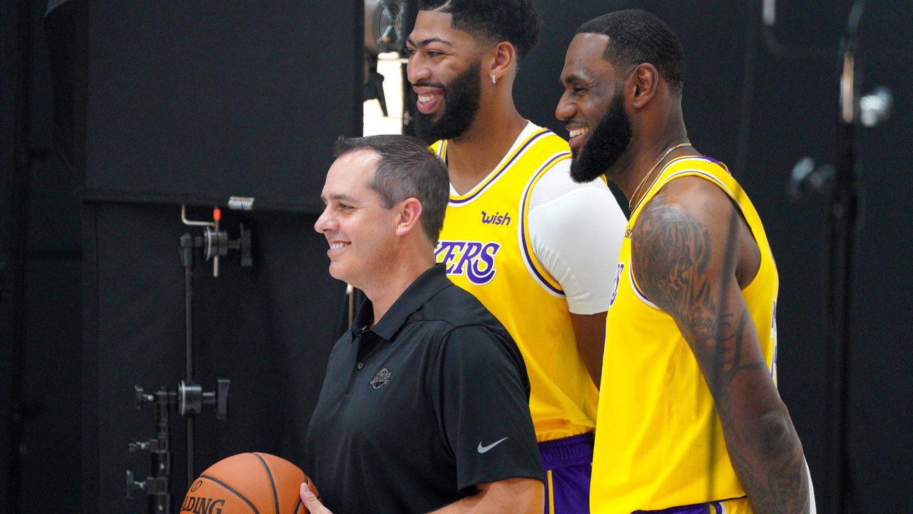 "EL SEGUNDO, CA - SEPTEMBER 27: Los Angeles Lakers head coach Frank Vogel, left, Anthony Davis and LeBron James, right, pose for a photo during the team""u2019s media day in El Segundo on Friday, Sep. 27, 2019."
