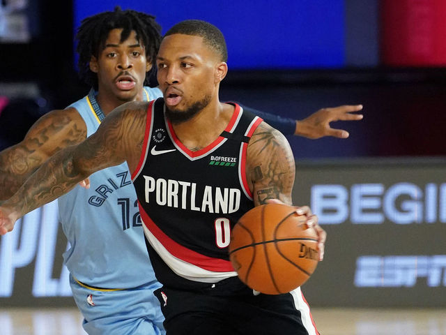 Damian Lillard drives by Ja Morant in the 2020 NBA play-in game