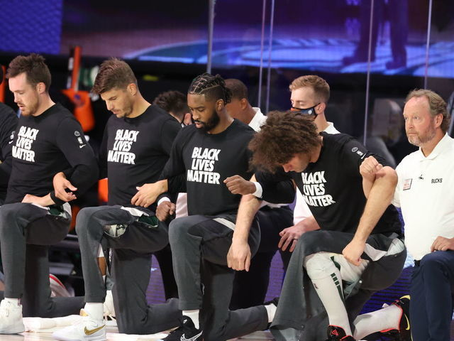 ORLANDO FL - AUGUST 20 The Milwaukee Bucks kneel during the National Anthem before the game against the Orlando Magic during Round One Game Two of the NBA Playoffs on August 20 2020 at the The Field House at ESPN Wide World Of Sports Complex in Orlando Florida NOTE TO USER User expressly acknowledges and agrees that by downloading andor using this Photograph user is consenting to the terms and conditions of the Getty Images License Agreement Mandatory Copyright Notice Copyright 2020 NBAE