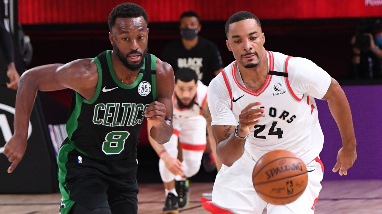 ORLANDO, FL - SEPTEMBER 11: Kemba Walker #8 of the Boston Celtics and Norman Powell #24 of the Toronto Raptors runs to grab the loose ball during Game Seven of the Eastern Conference SemiFinals of the NBA Playoffs on September 11, 2020 at AdventHealth Arena in Orlando, Florida. NOTE TO USER: User expressly acknowledges and agrees that, by downloading and/or using this Photograph, user is consenting to the terms and conditions of the Getty Images License Agreement. Mandatory Copyright Notice: Copyright 2020 NBAE