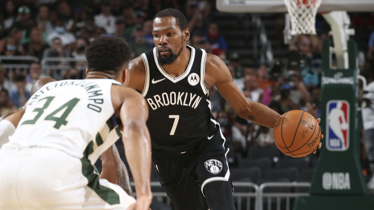 MILWAUKEE, WI - JUNE 13: Kevin Durant #7 of the Brooklyn Nets handles the ball as Giannis Antetokounmpo #34 of the Milwaukee Bucks plays defense during the game during Round 2, Game 4 of the 2021 NBA Playoffs on June 13, 2021 at the Fiserv Forum Center in Milwaukee, Wisconsin. Mandatory Copyright Notice: Copyright 2021 NBAE .