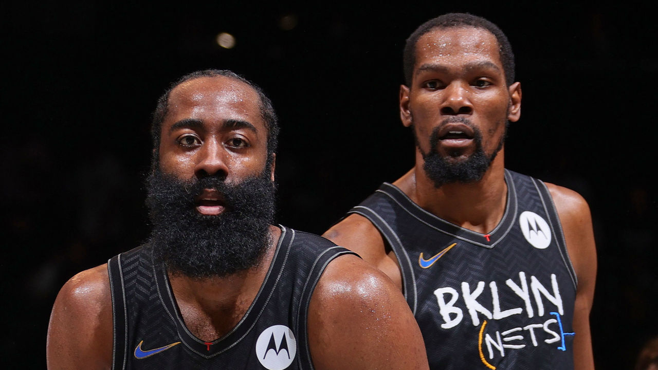BROOKLYN, NY - JUNE 15: James Harden #13 and Kevin Durant #7 of the Brooklyn Nets look on during Round 2, Game 5 of the 2021 NBA Playoffs on June 15, 2021 at Barclays Center in Brooklyn, New York. Mandatory Copyright Notice: Copyright 2021 NBAE