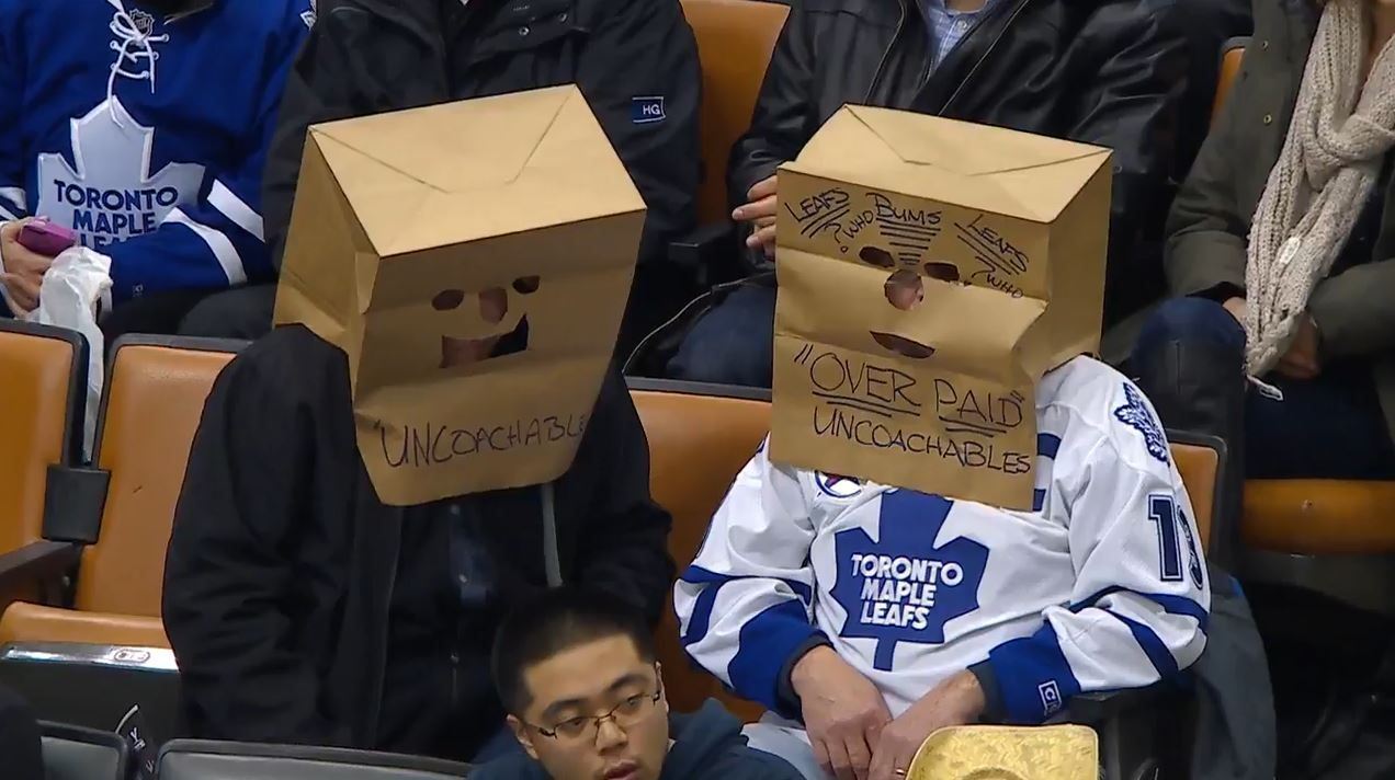 Photos Maple Leafs Fans Toss Jerseys On Ice Pull Paper Bags Over Heads Thescore Com